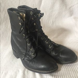 Black tight fitted lace up combat riding boots